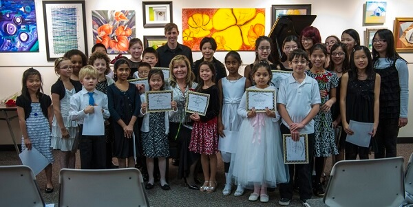 piano lessons culminate in performances - elza ritter and students at recital