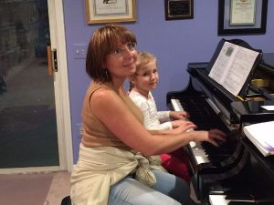Elza Ritter and young student during piano lesson January 2017