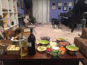 music studio with meetup snacks, pianos, and appreciative puppy dog